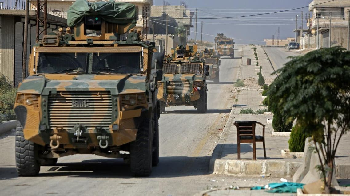 A convoy of Turkish military vehicles passes through the northern Syrian Kurdish town of Tal Abyad on the border between Syria and Turkey on October 31, 2019. (AFP)