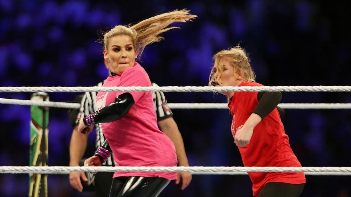 Natalya in action with Lacey Evans during the first-ever women's fight match to be held in Saudi Arabia. (Reuters)