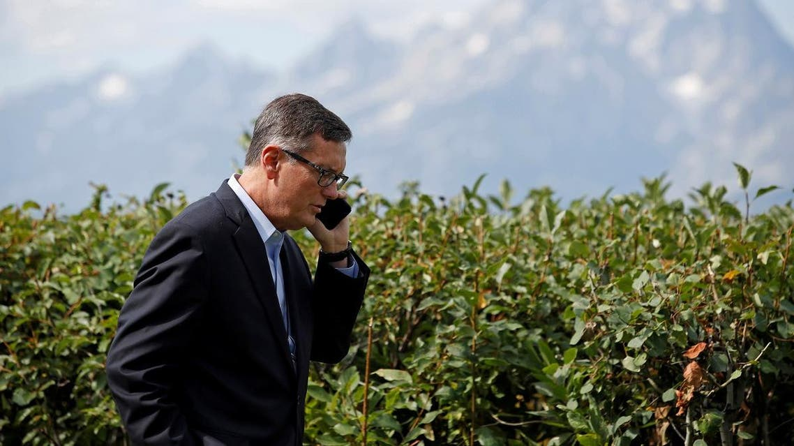 """Federal Reserve Vice Chair Richard Clarida talks on the phone during the three-day """"Challenges for Monetary Policy"""" conference in Jackson Hole. (File photo: Reuters)"""