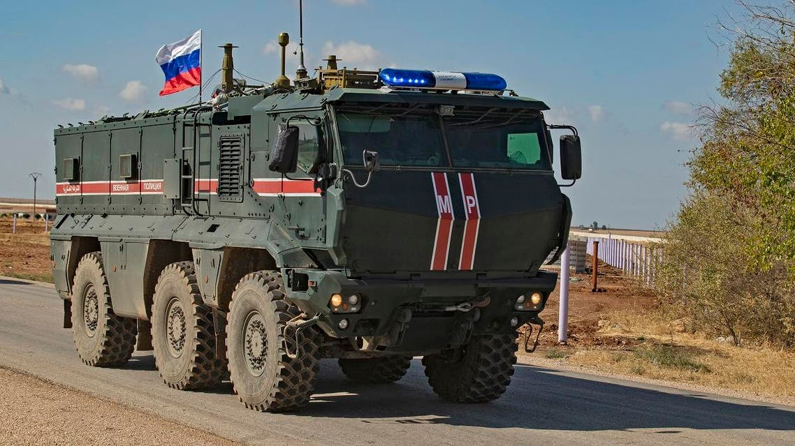 A Russian army vehicle takes part in a patrol of members of the Syrian Kurdish Asayish internal security forces and Russian military police in the town of Darbasiyah in Syria's northeastern Hasakeh province along the Syria-Turkey border on October 30, 2019. (AFP)