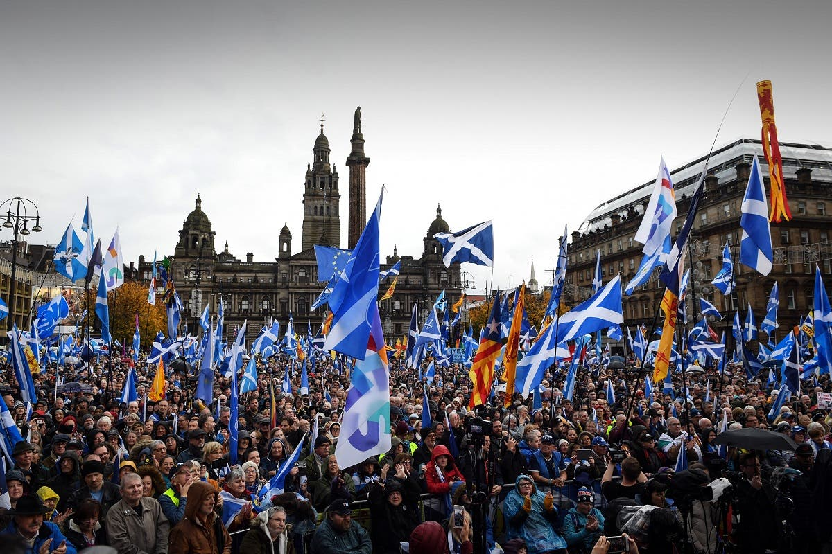 Pro Scottish Independence campaigners listen as Scottish Nationalist Party (SNP) leader Nicola Sturgeon, Scotland's First Minister addresses a rally calling for Scottish independence in Glasgow on November 2, 2019. (AFP)