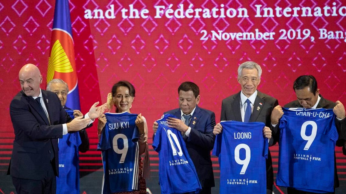 FIFA president Gianni Infantino (left), claps as ASEAN leaders hold soccer jerseys with their names during a ceremony to signing of memorandum of understanding between The ASEAN and FIFA in Nonthaburi, Thailand, on November2, 2019. (AP)