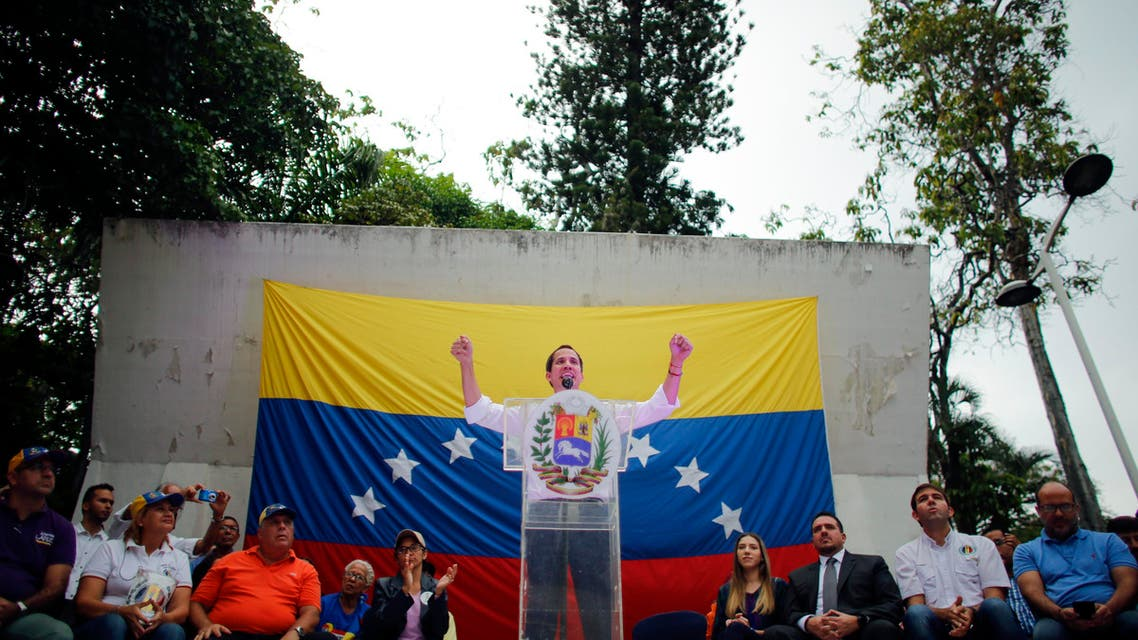 Opposition leader and self-proclaimed interim President Juan Guaido speaks during a citizen assembly at a square in the neighborhood of El Paradiso in Caracas, Venezuela, Monday, Sept. 30, 2019. (AP)