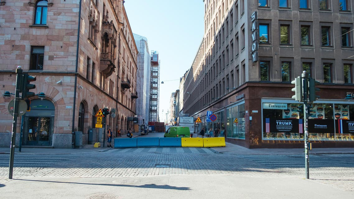 Barricades are pictured along Esplanadi street, near the area of the Finnish Presidential palace in Helsinki, Finland, on July 16, 2018, (AP)