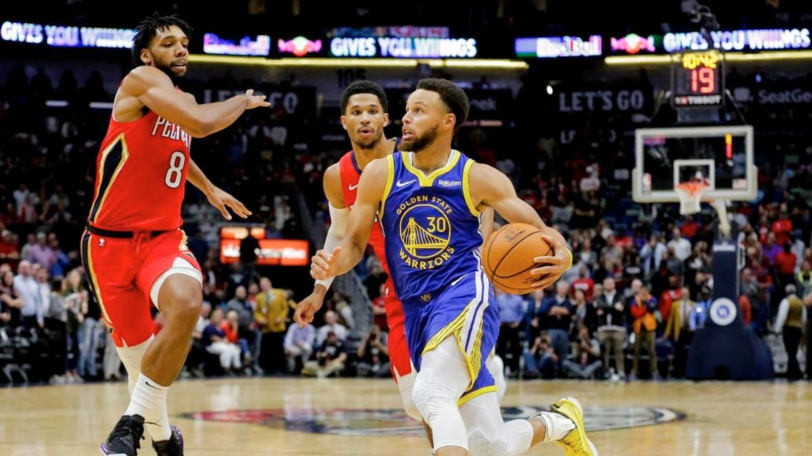 Golden State Warriors guard Stephen Curry (30) drives past New Orleans Pelicans guard Josh Hart (3) and center Jahlil Okafor (8) during the first quarter at the Smoothie King Center. Mandatory Credit: Derick E. Hingle-USA TODAY Sports