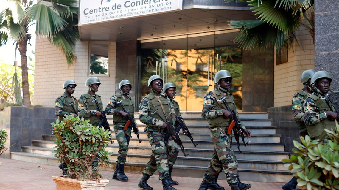 Nov. 21, 2015 file photo, soldiers from the presidential guard patrol outside the Radisson Blu hotel in Bamako after it was attacked by Islamic extremists armed with guns and grenades. (AP)