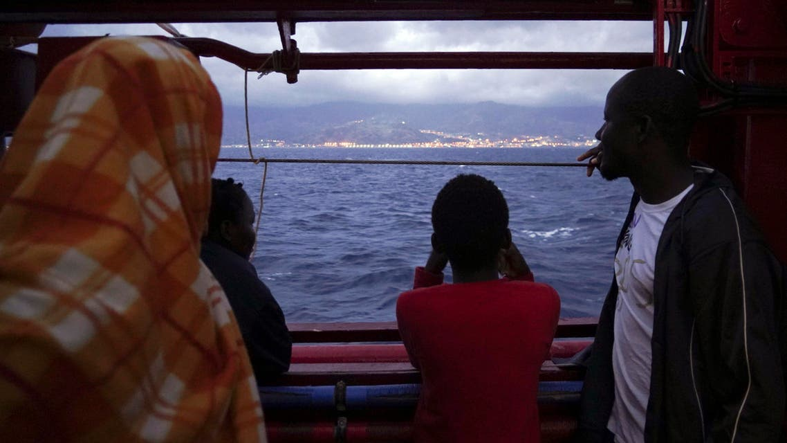 Migrants look at the Italian shoreline from aboard the Ocean Viking as it approaches the Sicilian port of Messina, southern Italy, Tuesday, Sept. 24, 2019. The Ocean Viking has docked in Sicily, Italy, to disembark 182 men, women and children rescued in the Mediterranean Sea after fleeing Libya. (AP)