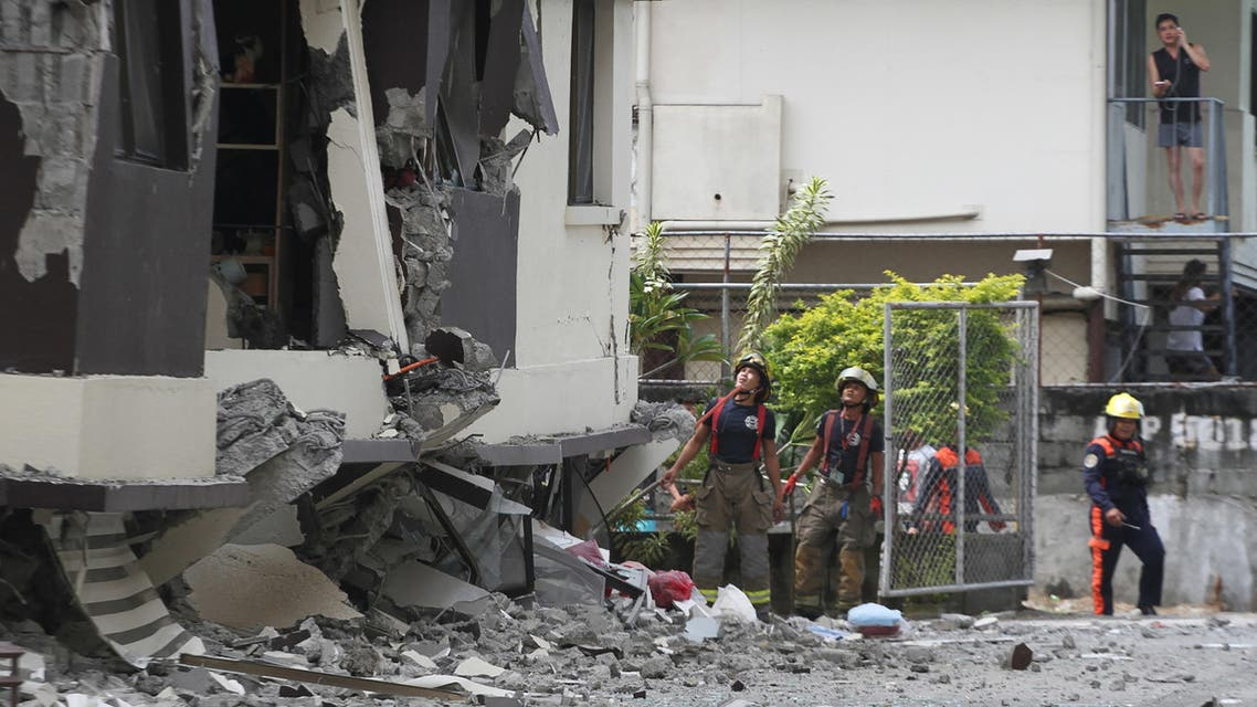 Rescuers look at the damaged condominium building after a 6.5-magnitude earthquake hit Davao City in the southern island of Mindanao on October 31, 2019. (AFP)