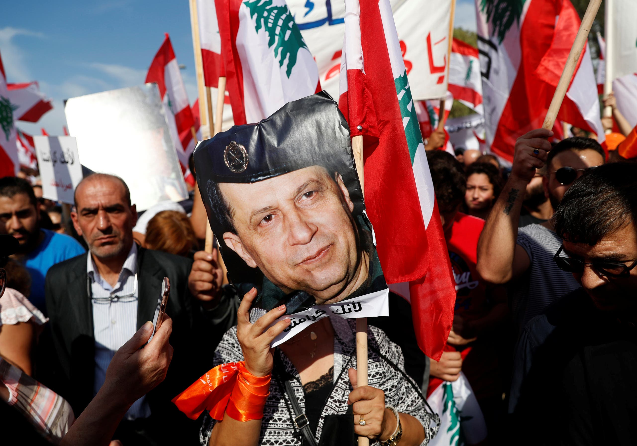A supporter of Lebanon's President Michel Aoun holds his pictures during a rally in Baabda near Beirut, Lebanon. (Reuters)