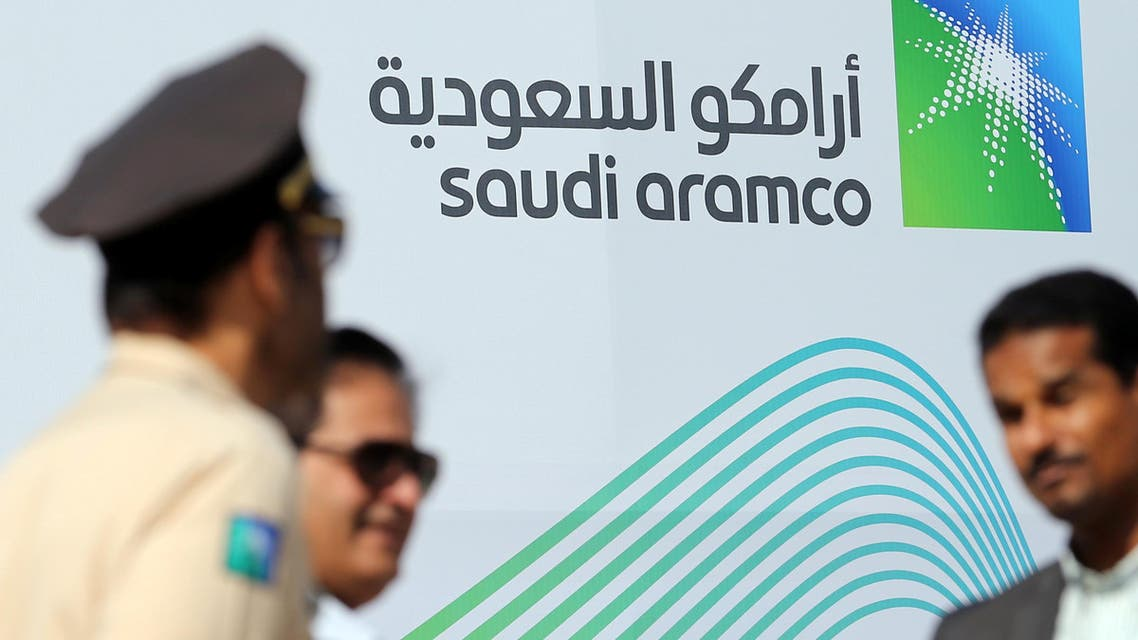 The logo of Aramco is seen as security personnel stand before the start of a press conference by Aramco at the Plaza Conference Center in Dhahran, Saudi Arabia November 3, 2019. REUTERS/Hamad I Mohammed