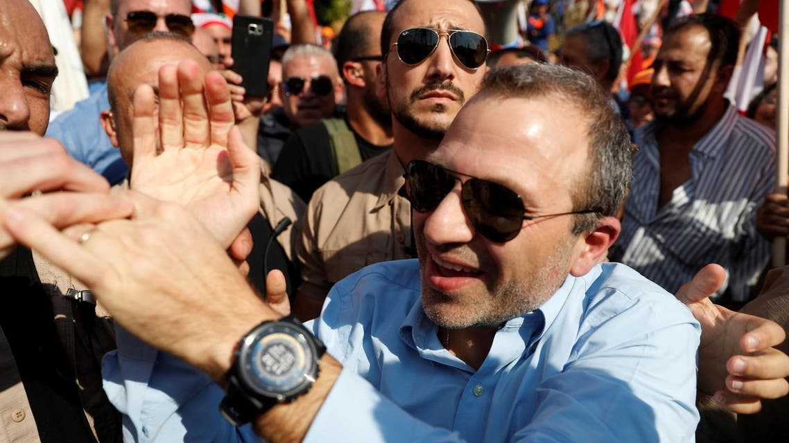 Lebanese caretaker foreign minister, Gebran Bassil greets his supporters during a rally in Baabda near Beirut, Lebanon, November 3, 2019. REUTERS