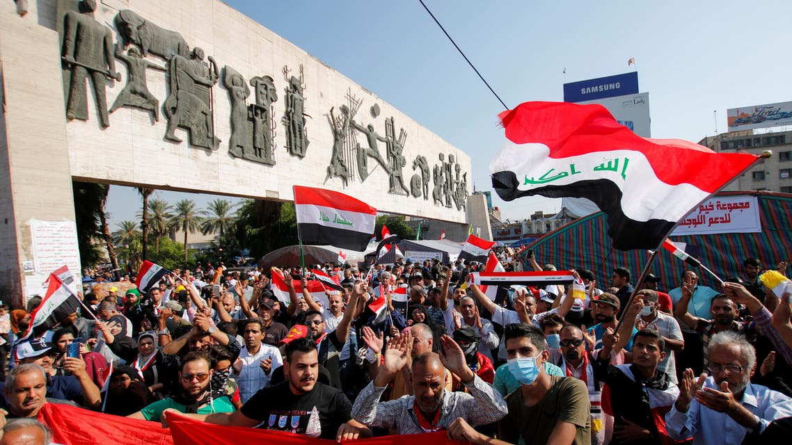 Iraqi demonstrators take part at ongoing anti-government protests at Tahrir Square in Baghdad (reuters)