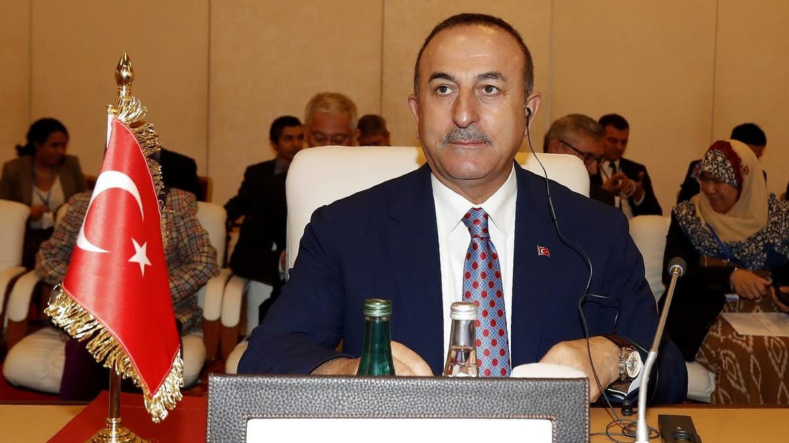 Turkey's Foreign Minister Mevlut Cavusoglu attends the ministerial meeting of the Organiztion of Islamic Cooperation's (OIC) contact group on Somalia in the Qatari capital Doha on November 3, 2019. (AFP)