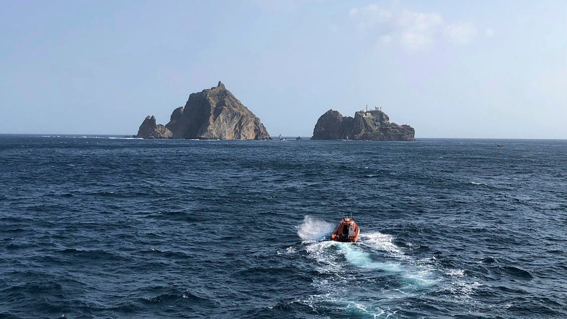 In this photo provided by the Korea Coast Guard, search and rescue operations underway in waters following the crash of an ambulance helicopter near the South Korea-controlled islets of Dokdo in waters between the Korean Peninsula and Japan, Friday, Nov. 1, 2019. (AP)