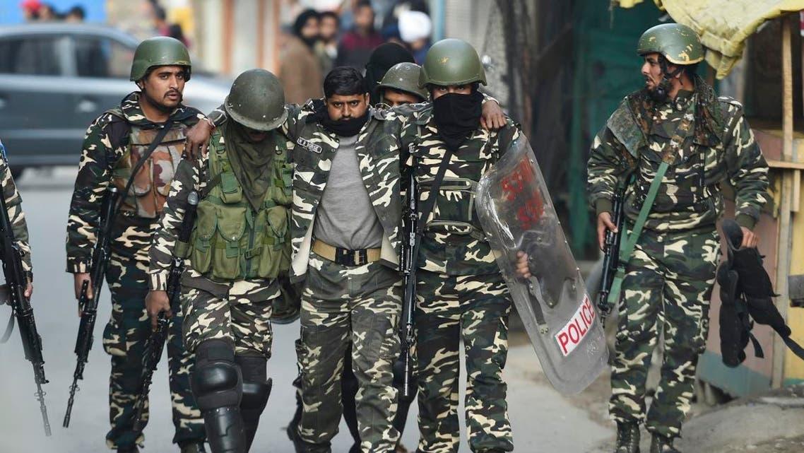 Soldiers evacuate an injured comrade after a grenade blast at a market in Srinagar on November 4, 2019. (AFP)