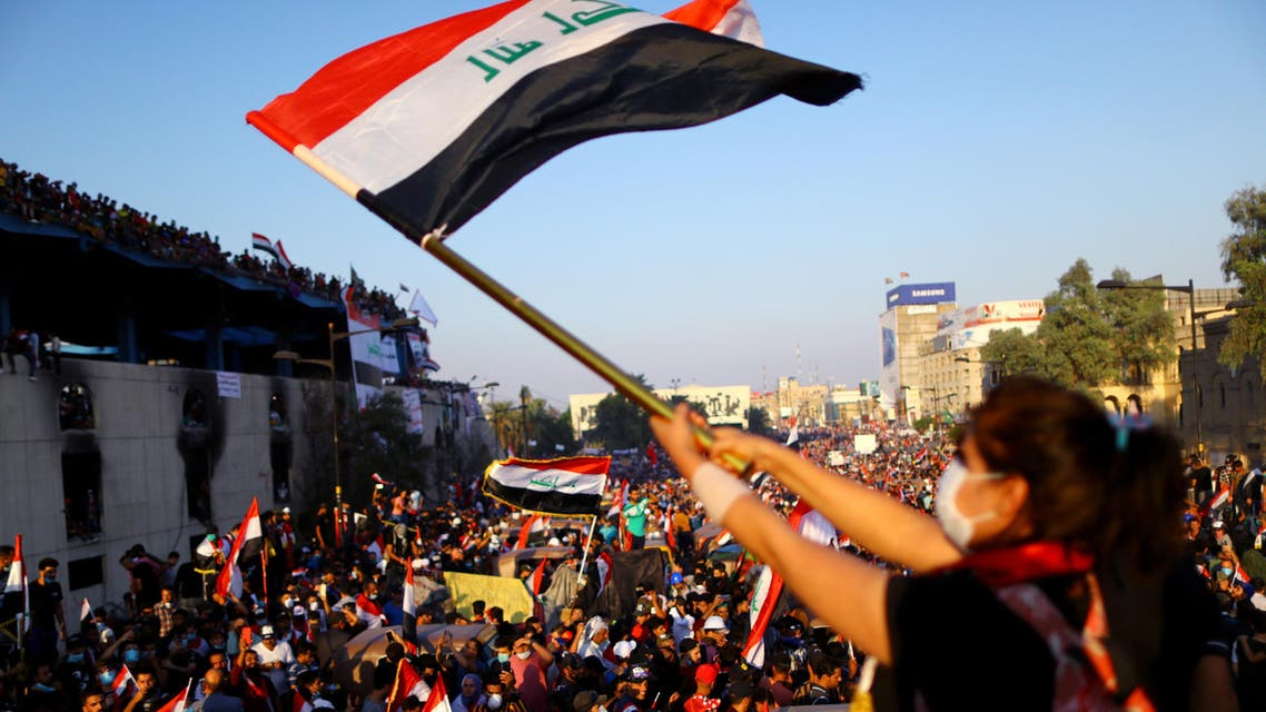 An Iraqi female demonstrator waves an Iraqi flag during an ongoing anti-government protest, in Baghdad, Iraq November 1, 2019. REUTERS