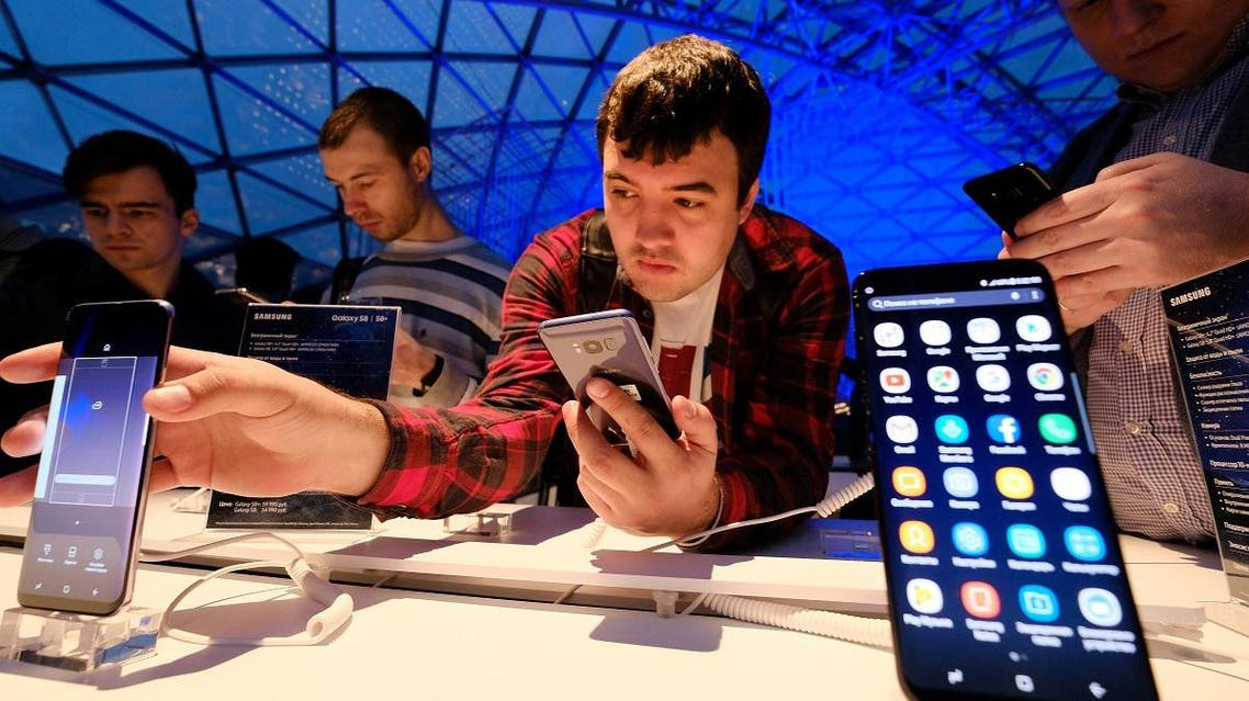 A man looks at Samsung smartphones during a presentation of the new Samsung Galaxy S8 at the Russian market of electronic devices in Moscow, on April 13, 2017. (AFP)