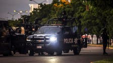 At least 23 bodies found in a hidden grave near a police base in Mexico
