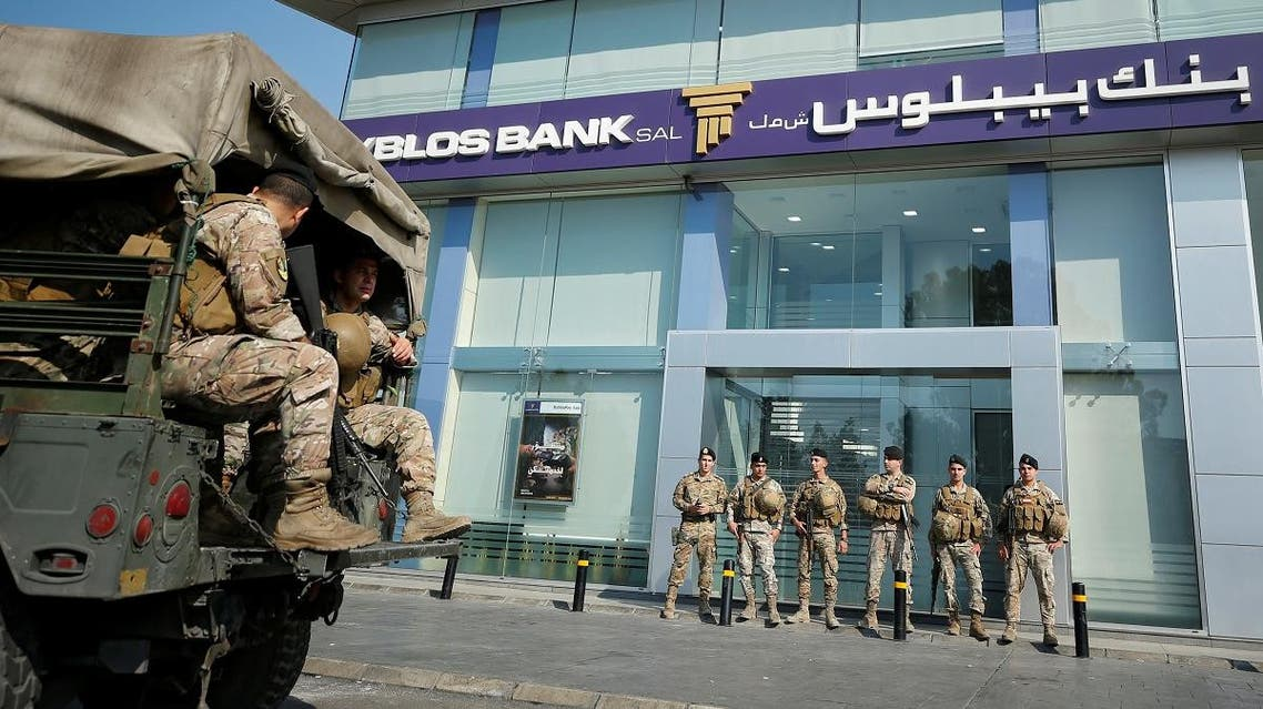 Lebanese army soldiers stand guard outside a branch of Byblos Bank in the southern city of Sidon, Lebanon November 4, 2019. REUTERS