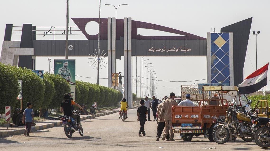 Iraqi protesters block the highway leading to Umm Qasr port during ongoing anti-government demonstrations in southern Iraq on November 3, 2019. (AFP)