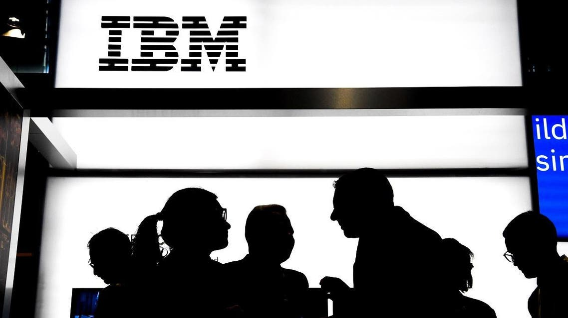 file photo taken on May 16, 2019 people talk at the stand of the US multinational information technology company International Business Machines Corporation (IBM), during the Vivatech startups and innovation fair, in Paris. (AFP)