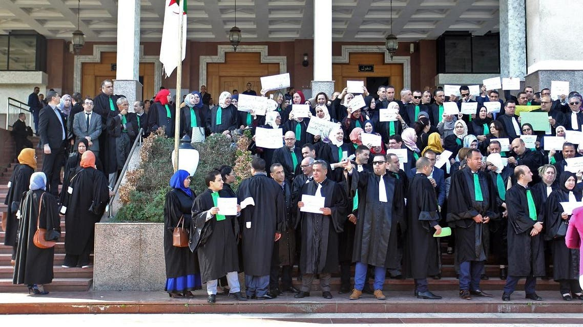 Algerian judges and prosecutors lift placards during a protest in front of the judicial council in the capital Algiers on October 29, 2019. (AFP)