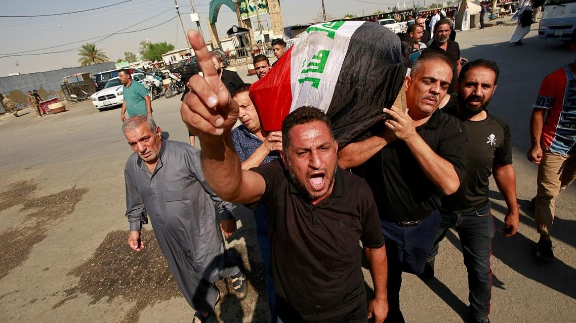Mourner reacts as others carry the coffin of a demonstrator who was killed at anti-government protests, during a funeral in Najaf. (Reuters)