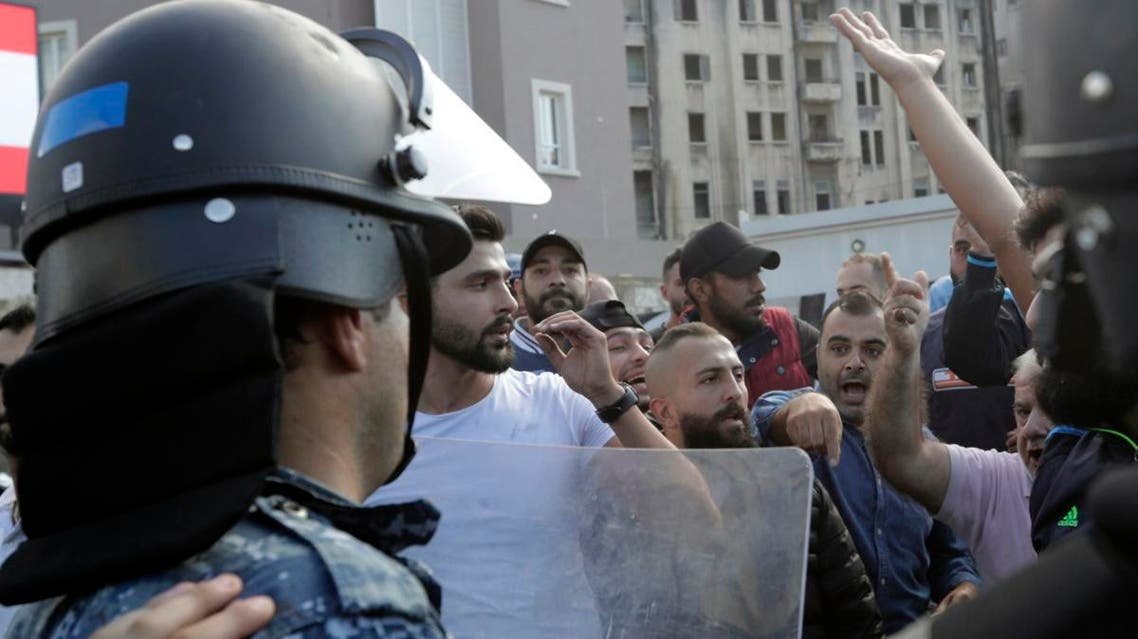 Lebanese security forces intervene to seperate between demonstrators and counter-protesters in the centre of the capital Beirut during the 13th day of anti-government protests on October 29, 2019. (AFP)