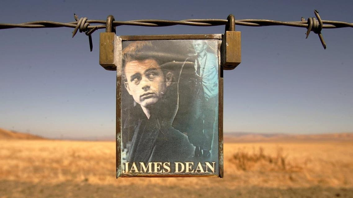 Photo caption from Reuters: A portrait of U.S. actor James Dean hangs from a fence near the intersection of Highways 46 and 41 near Cholame, California September 30, 2005. (Reuters)