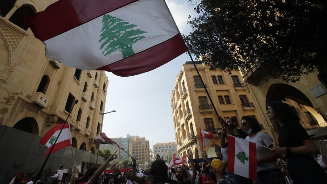 Protesters wave the national flag in downtown beirut on October 19, 2019. (AFP)