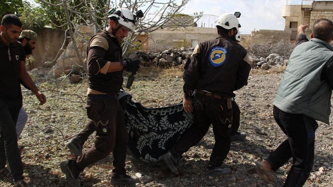 Members of the Syrian Civil Defence (White Helmets) carry away one of the victims of a Russian airstrike that hit the village of Jaballa in the south of the Idlib region on November 2, 2019. (AFP)