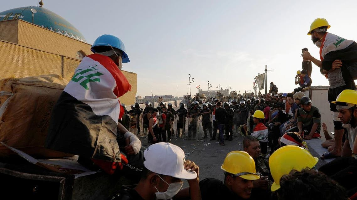 Demonstrators block Al Shuhada bridge during ongoing anti-government protests, in Baghdad, Iraq November 5, 2019. REUTERS