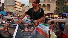 عراقی مظاہروں میں ایرانی قیادت کے خلاف جوتوں کا استعمال