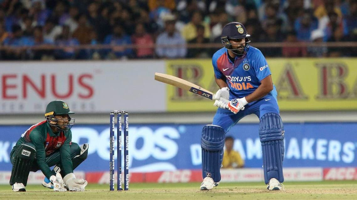 India's captain Rohit Sharma prepares to play a shot during the second Twenty20 international cricket match against Bangladesh in Rajkot, India, on November 7, 2019. (AP)