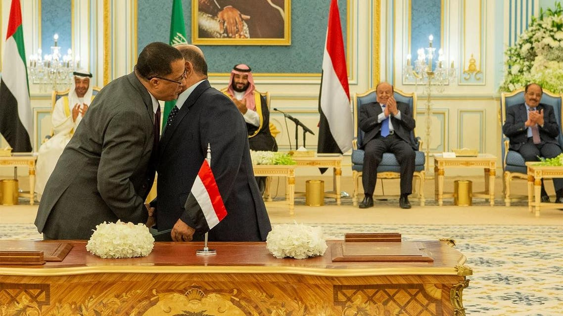 Representatives of Yemen's government and southern separatists embrace each other after signing a Saudi-brokered deal to end a power struggle in the southern port of Aden, in Riyadh. (Reuters)