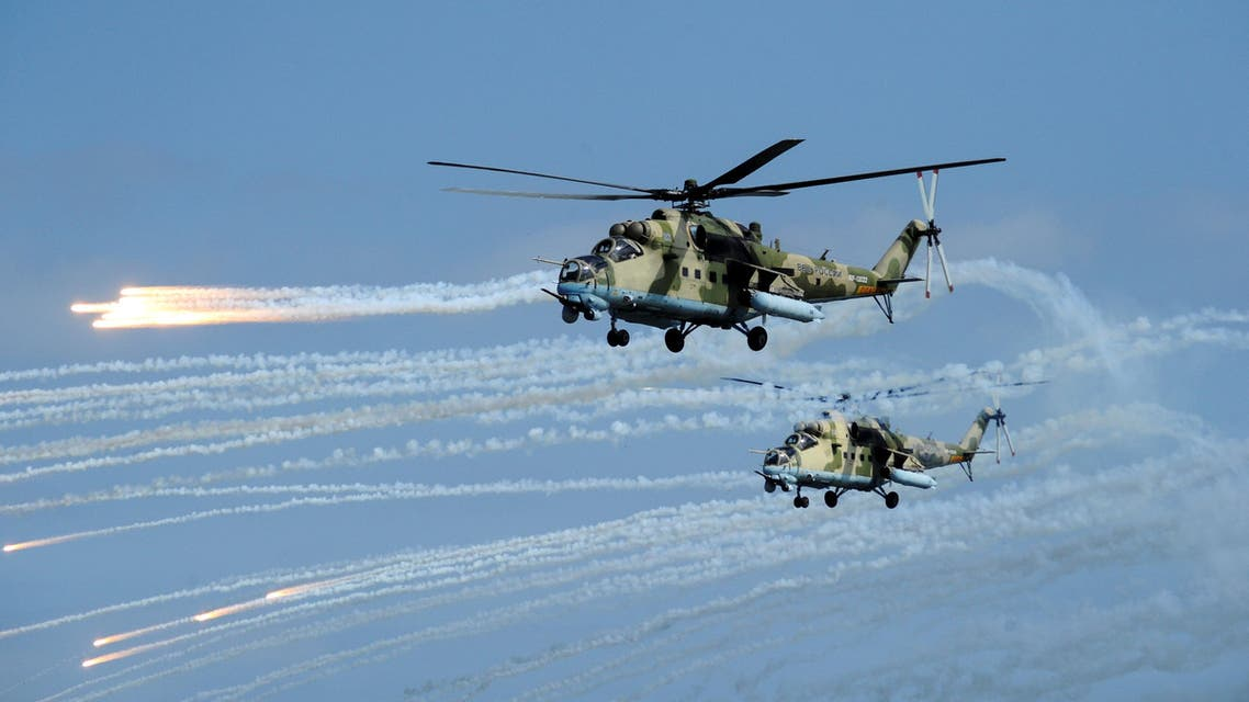 Russian Mi-35 helicopters fire during military exercises in Dagestan, 2019 - Reuters