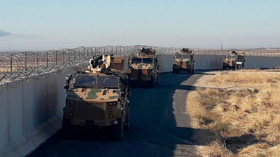 Turkish army armoured vehicles arrive near the Turkish town of Idil at the Turkey-Syria border before Turkish and Russian troops conduct their third joint patrols in northeast Syria, Friday, Nov. 8, 2019. (AP)