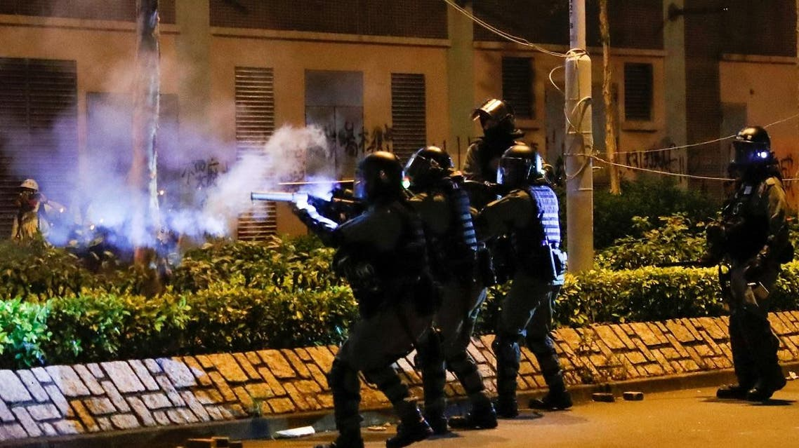 Riot police disperse anti-government protesters, after Chow Tsz-lok, 22, a university student, died after he fell during a protest, at Tseung Kwan O, Hong Kong, China November 9, 2019. (Reuters)