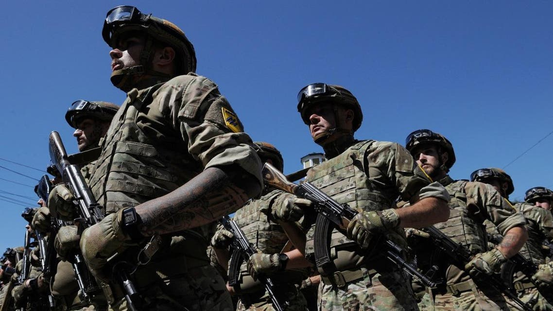 """Servicemen of the """"Azov"""" regiment take part in a parade to mark the 5th anniversary of city's liberation from the Russia-backed rebels, on June 15, 2019 in Mariupol. Evgeniya MAKSYMOVA / AFP"""