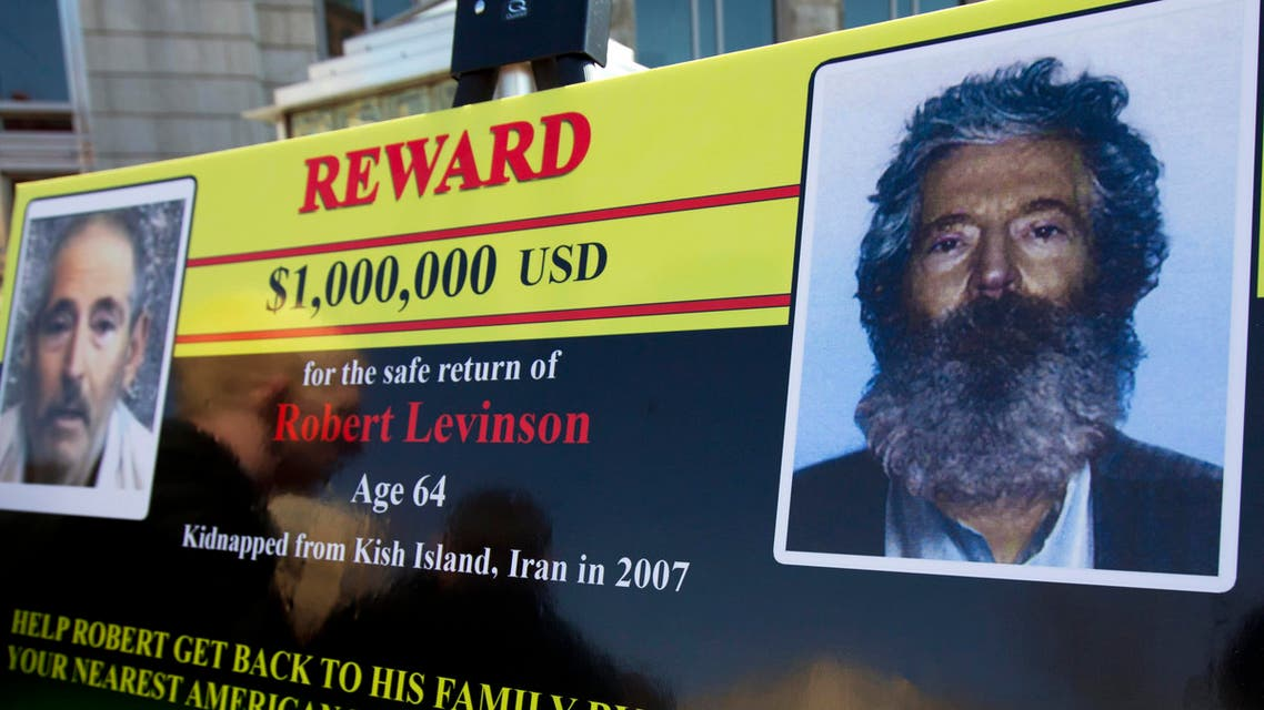 an FBI poster showing a composite image of former FBI agent Robert Levinson, right, of how he would look like after then-five years in captivity, and an image, left, taken from the video, released by his kidnappers in Washington during a news conference. (AP)
