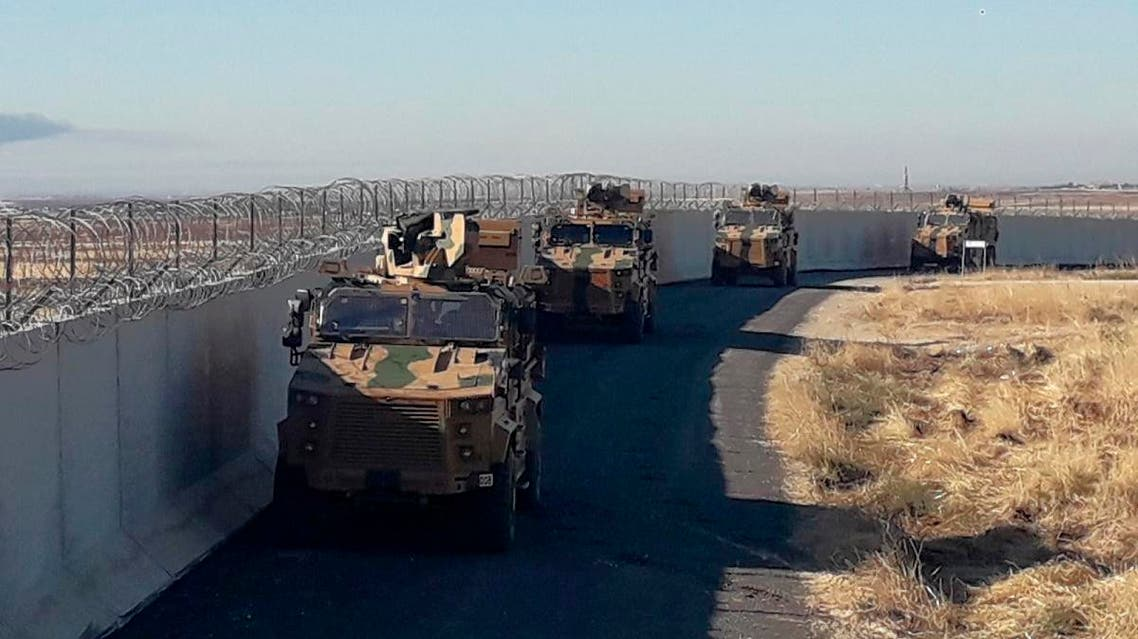 Turkish army armored vehicles arrive near the Turkish town of Idil at the Turkey-Syria border before Turkish and Russian troops conduct their third joint patrols in northeast Syria, on November 8, 2019. (AP)