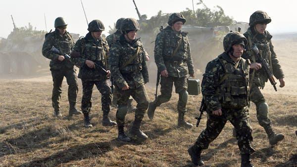 أوكرانيا والانفصاليون يسحبون قواتهما تمهيداً لقمة سلام