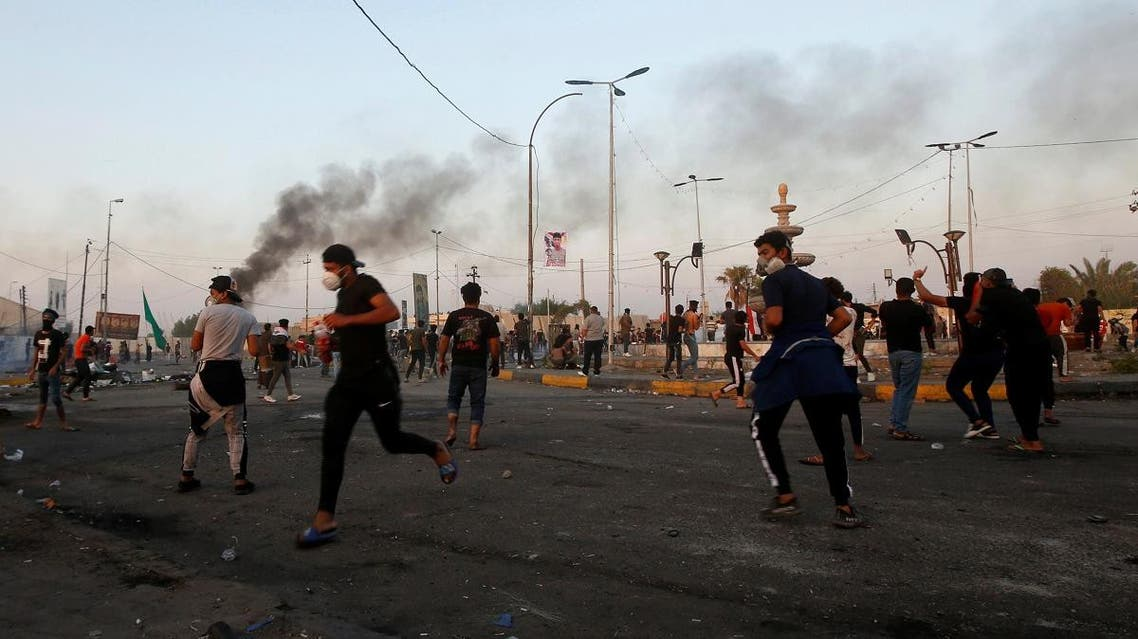Demonstrators clash with members of Iraqi security forces during the ongoing anti-government protests near the Governorate building of Basra, Iraq November 8, 2019. REUTERS