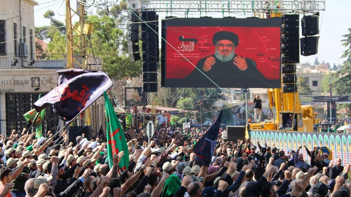Hezbollah supporters watch a televised speech by Hassan Nasrallah, during a religious festival in Baalbeck in Lebanon's eastern Bekaa Valley on October 19, 2019. (AFP)