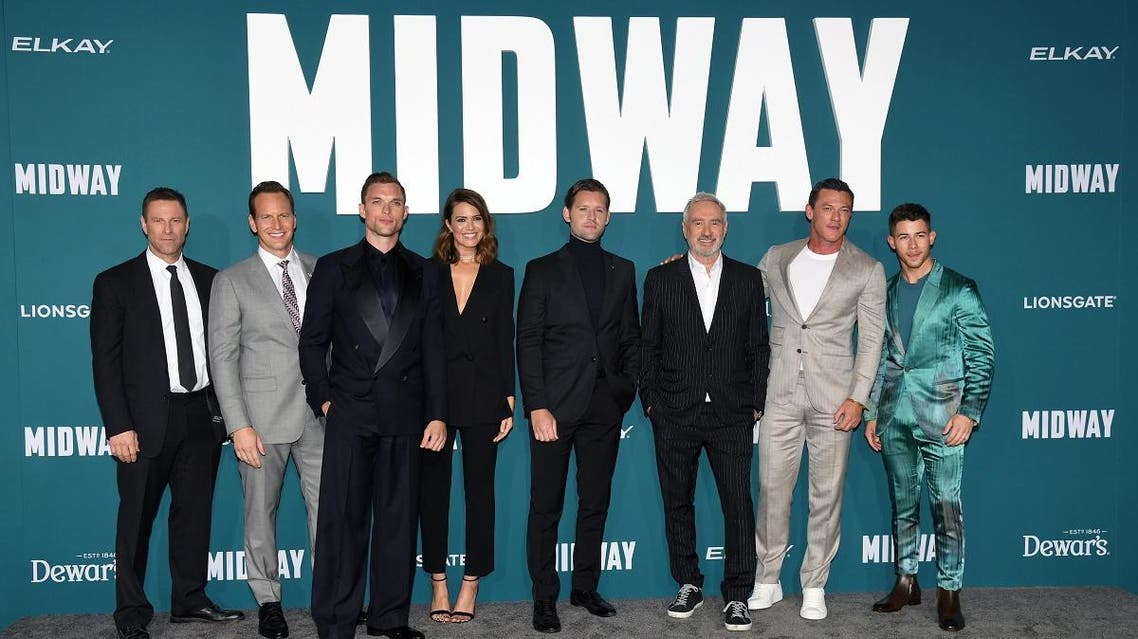 "(L-R) Aaron Eckhart, Patrick Wilson, Ed Skrein, Mandy Moore, Luke Kleintank, Roland Emmerich, Luke Evans, and Nick Jonas attend the premiere ""Midway"" at Regency Village Theatre on Nov. 05, 2019 in Westwood, California. (AFP)"