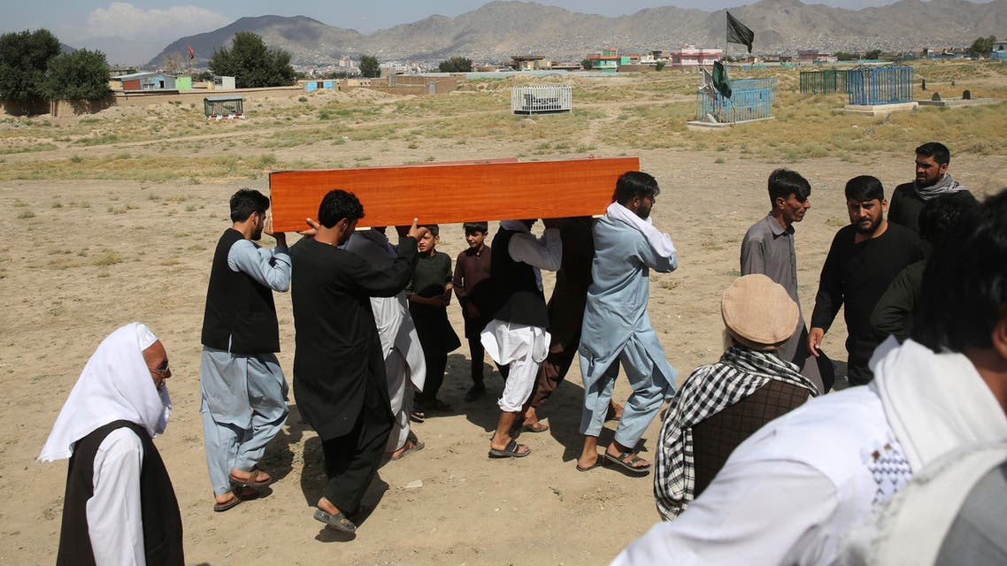 Afghans carry the body of a victim of Dubai City wedding hall bombing during a mass funeral in Kabul, Afghanistan, Sunday, Aug.18, 2019. The deadly bombing at the wedding in Afghanistan's capital (AP)