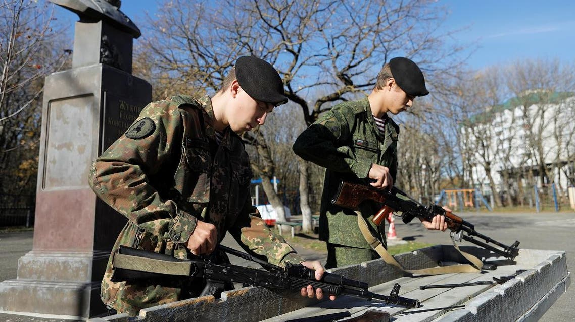 Students of the General Yermolov Cadet School assemble a Kalashnikov assault rifle and a machine gun during a demonstration lesson marking the upcoming Russian gunsmith Mikhail Kalashnikov's 100th anniversary of birth in Stavropol, Russia November 8, 2019. REUTERS
