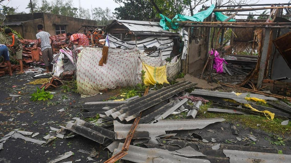 Villagers clear debris from their homes damaged by Cyclone Bulbul in Bakkhali on November 10, 2019. (AFP)