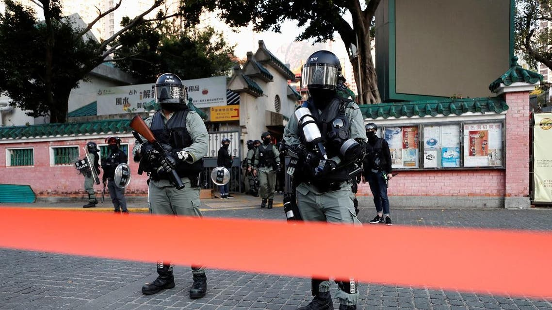 Riot police stand guard in Wong Tai Sin district, as protesters called for a general strike, in Hong Kong. (Reuters)