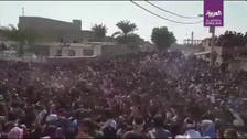 Thousands of protesters march in funeral held for dissident poet in Ahwaz